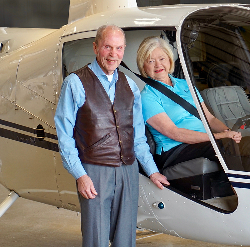 Ray and Linda Booker in a helicopter