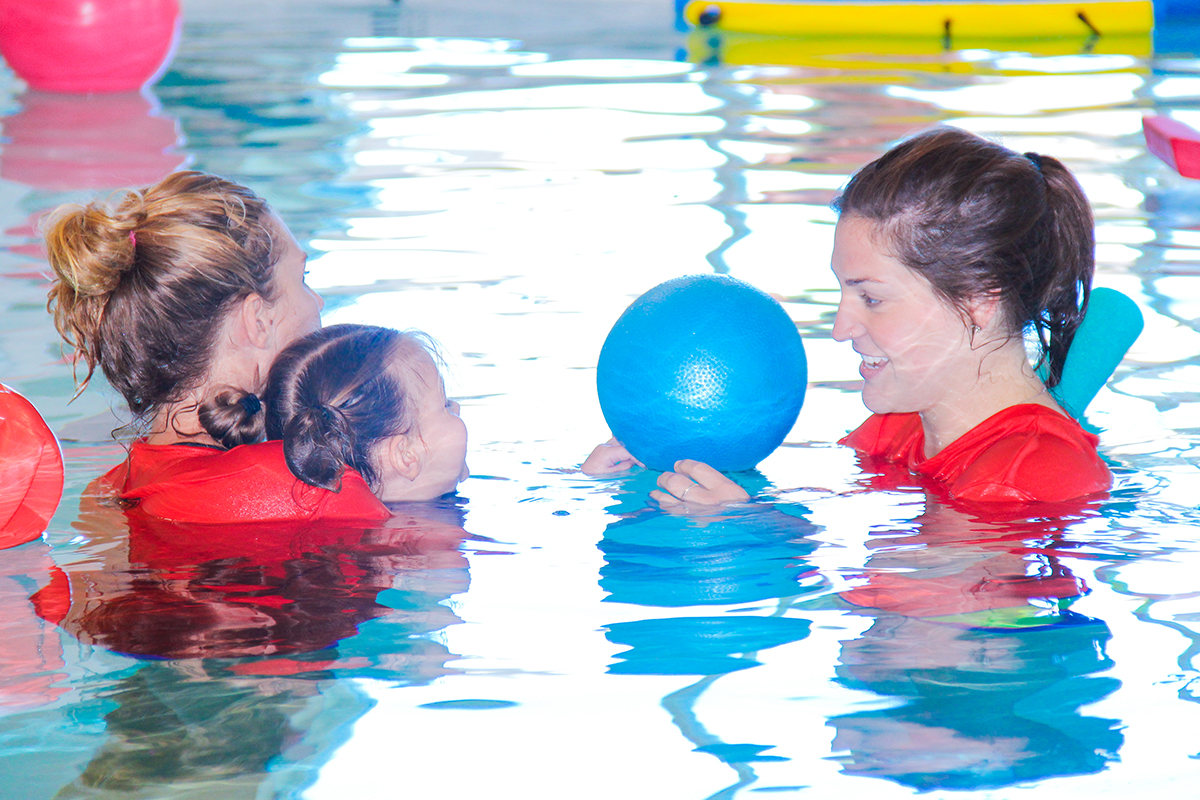 Students and children in the Warm Water Therapy pool